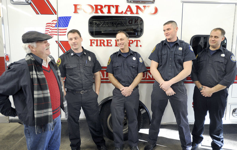 Robert Nannay, left, of Old Orchard Beach, visits Portland firefighters at Ladder Company No. 3 on Saturday. From left are Lt. John Hendricks and firefighters Ralph Munroe, Ryan Walsh and Wendell Howard.
