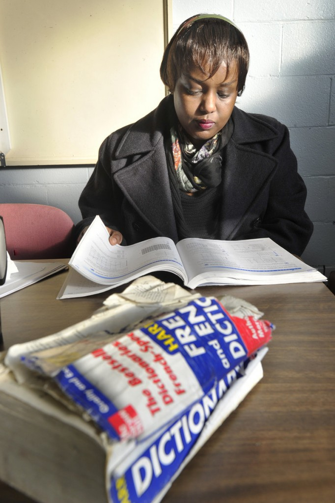 A heavily thumbed French-English dictionary sits in front of Francine Kaneza Nkomje, who was getting in some last-minute studying for an upcoming test before her English class at Portland Adult Education.
