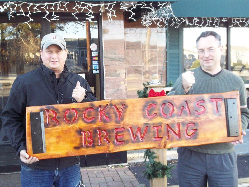 Jim Orser, left, and Andy Tomlinson display a sign they have yet to install at their brewery entrance in the Post Road Tavern in Ogunquit.