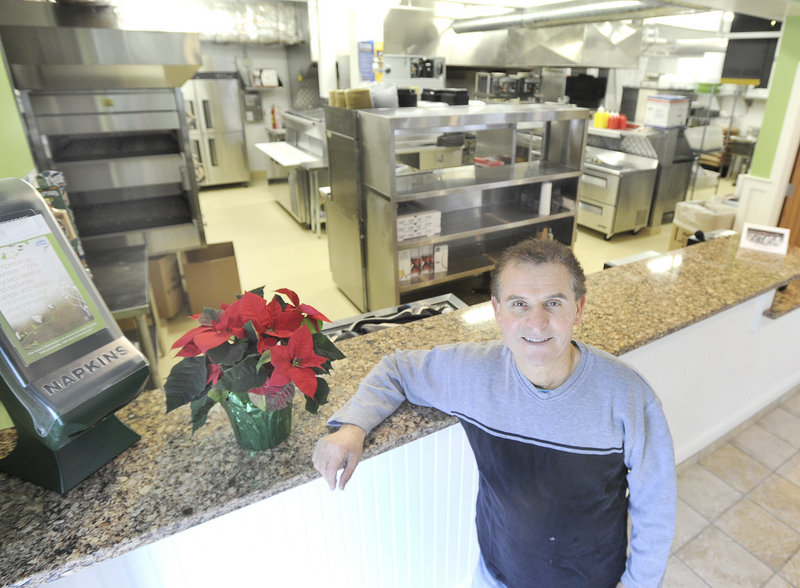 Gorham House of Pizza owner Angelo Sotiropoulos is ready to reopen Wednesday after a fire. Here, Sotiropoulos is seen in his restaurant's new kitchen on Monday, Dec. 17, 2012.