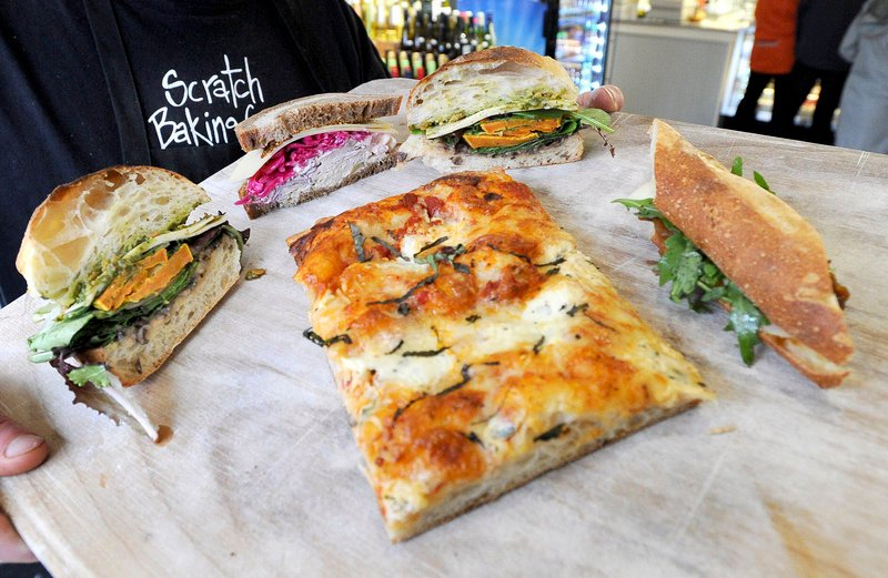 Three-cheese pizza and veggie and roast turkey sandwiches at Scratch Baking Co.