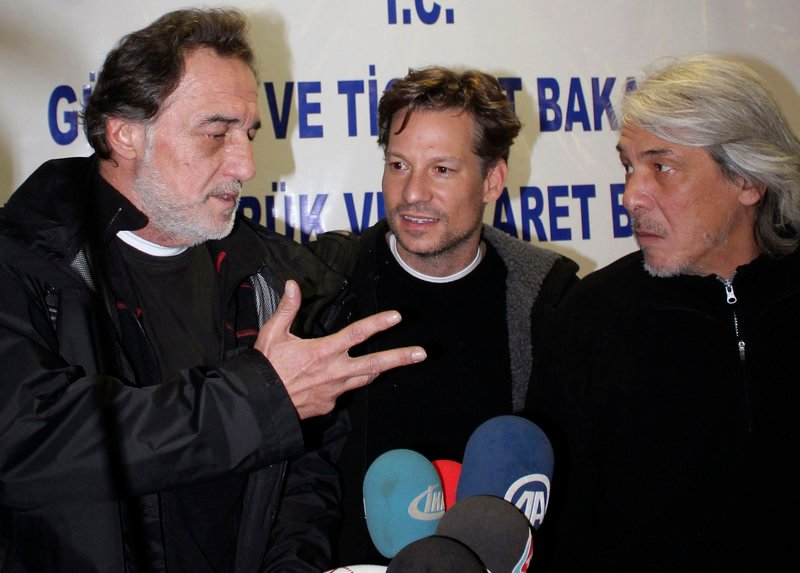 NBC chief foreign correspondent Richard Engel, center, NBC Turkey reporter Aziz Akyavas, left, and an unidentified NBC crew member, at a news conference in Reyhanli, Turkey, Tuesday.