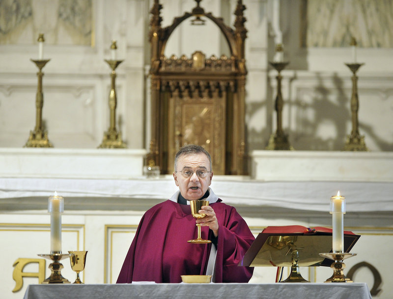 """The Rev. Michael Seavey celebrates Mass for parishioners at the Cathedral of the Immaculate Conception in Portland on Thursday afternoon. For his Sunday homily, he said, """"the bottom line has got to be hope."""""""