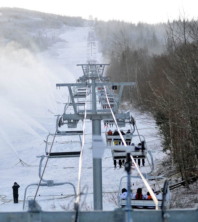 Snow guns cover a slope last December at Sugarloaf in Carrabassett Valley, Maine. The 2011-2012 ski season marked the lowest national average snowfall in 20 years, forcing resorts to rely heavily on snow-making.