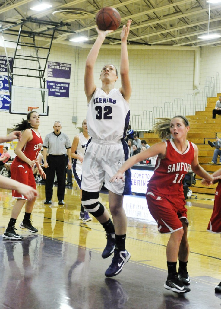 Marissa MacMillan of Deering shoots after grabbing an offensive rebound in the first half. MacMillan keyed a17-4 run in the first half that put the Rams in control.