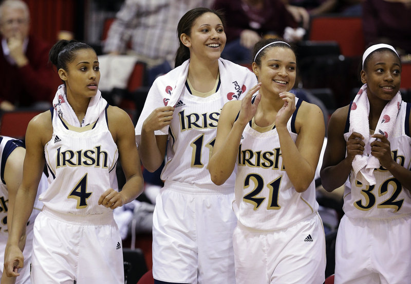 Notre Dame's Skylar Diggins, left, Natalie Achonwa, Kayla McBride and Jewell Loyd are all smiles as they watch the end of a 87-57 win over Kansas State in Las Vegas on Thursday.