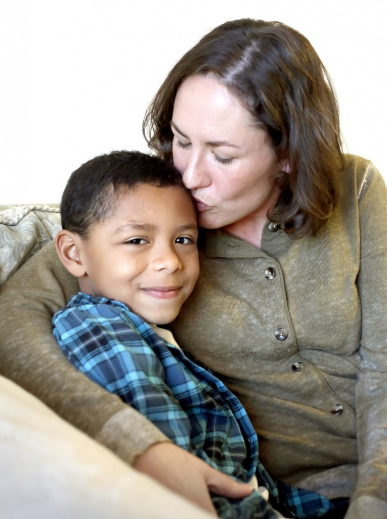 Max Ngabo, 8, and his mother Wanda Brann of Portland, in their home on Dec. 20, 2012.