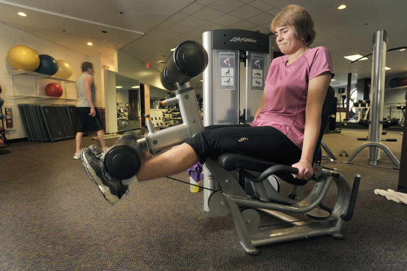 Michele Reynolds, a member of the Bay Club fitness center in Portland, works out on exercise machines regularly to keep in shape. Reynolds vowed to get healthier this year, and succeeded – shedding 13 pounds with a better diet and workouts during her lunch breaks.