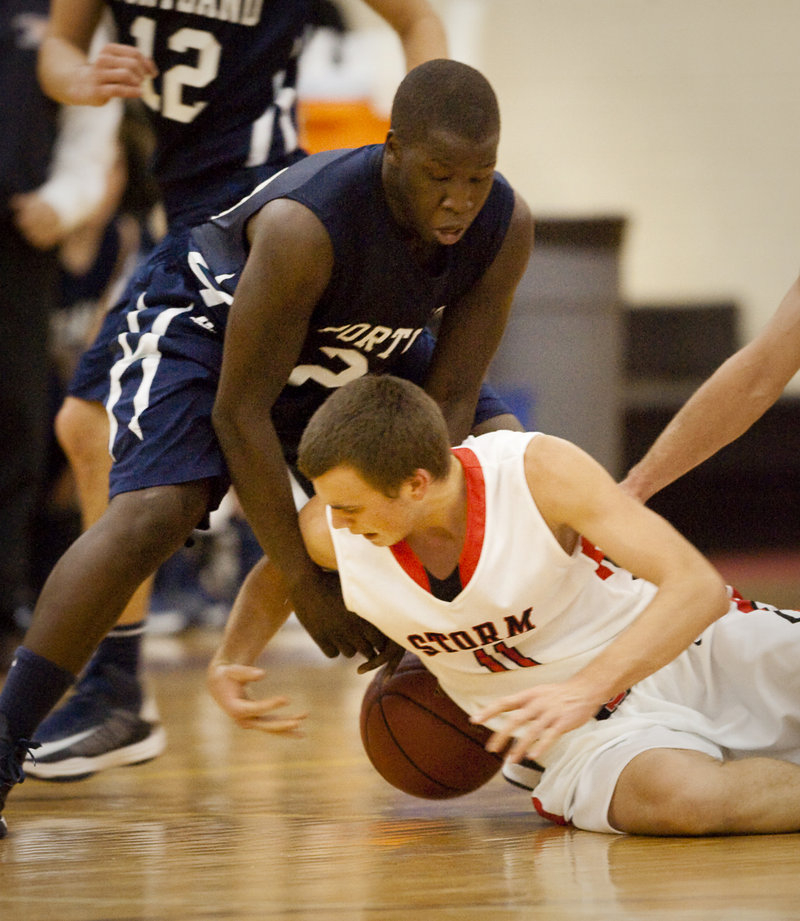 Sam Terry of Scarborough hits the floor to try to grab a loose ball against Portland's Steve Angelo.