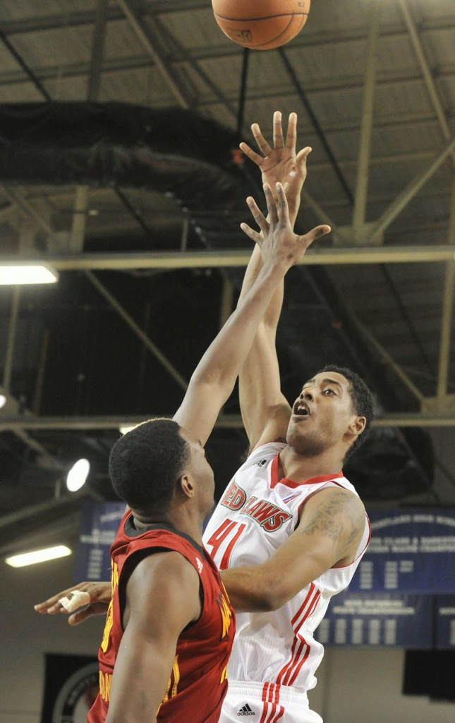 Maine's Fab Melo extends for a shot against Fort Wayne on Friday night at the Portland Expo. Melo had eight points and six rebounds.