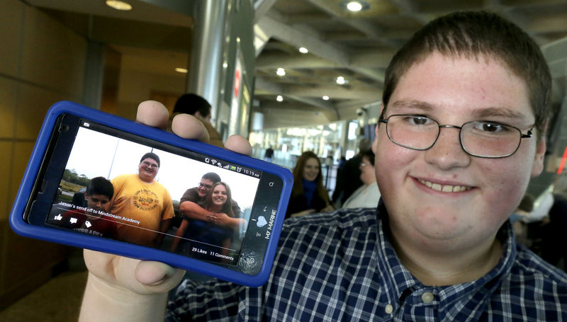 Jason, 16, shows a photo taken four months ago when he was nearly 100 pounds heavier.