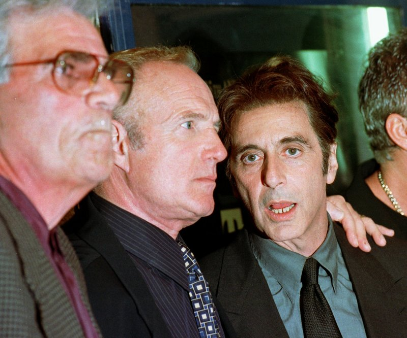 """Actors Al Pacino, right, James Caan, center, and Alex Rocco attend the 25th anniversary premiere of the movie of """"The Godfather"""" in San Francisco in 1997."""