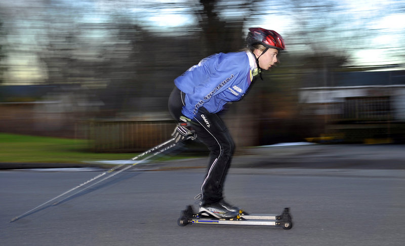 Abby Popenoe of Portland High trains on a city street while preparing for the upcoming high school ski season. Popenoe, a senior, placed third in the freestyle and ninth in the classic last season to help the Bulldogs finish second in the Class A Nordic portion of the state championships.