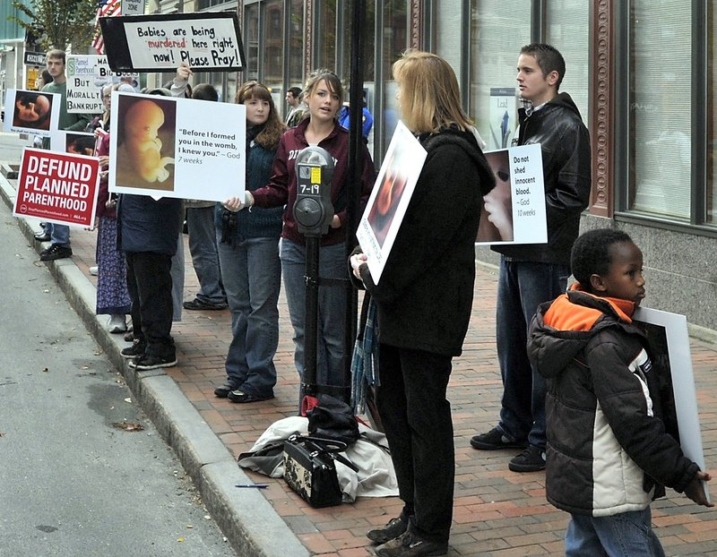 In this October file photo, anti-abortion demonstrators protest with graphic signs outside the Planned Parenthood of New England health clinic on Congress Street.