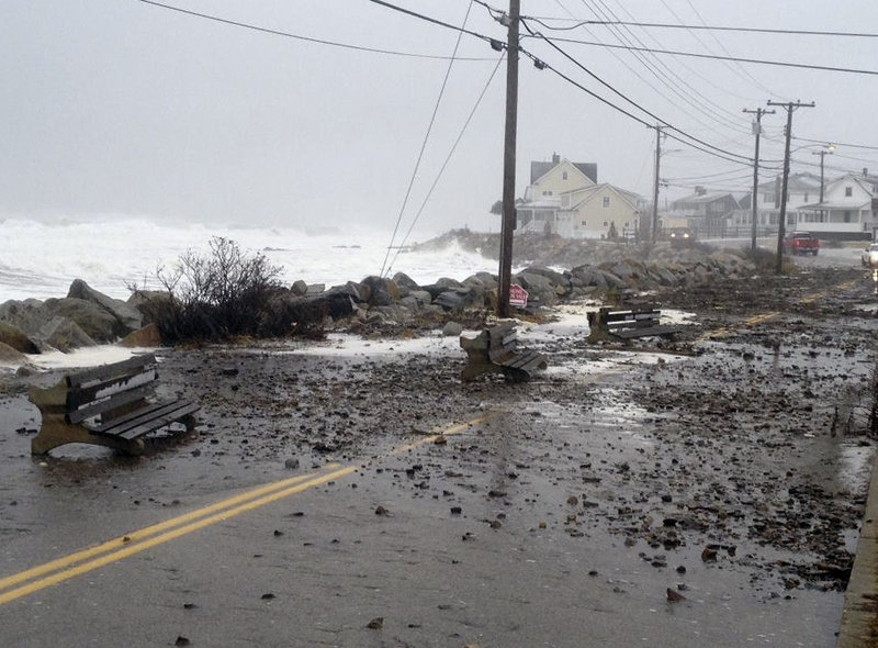 Police in Wells closed Webhannett Drive between Mile Road and the Crescent Beach area after surging waves from the nor'easter pushed debris into the road. Snow fell for more than 16 hours in areas of southern Maine.