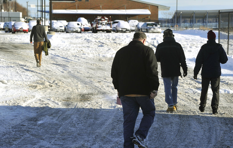 Portland residents retrieve their cars from the city's impound lot on Commercial Street on Friday, Dec. 28, 2012 after having them towed during the recent snowstorm.