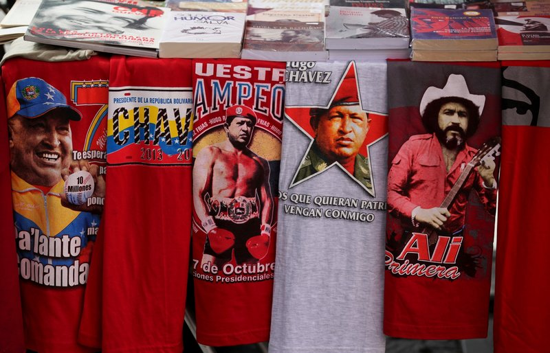 T-shirts with images of Venezuela's President Hugo Chavez are for sale next to a T-shirt of Venezuelan musician Ali Primera in Caracas, Venezuela, on Friday. Conversations about Chavez's health have dominated the country since its leader went to Cuba two weeks ago.