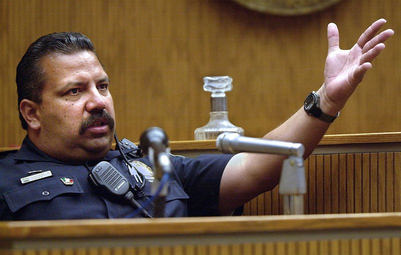 El Cajon (Calif.) Police Department school resource officer Rich Agundez Jr., who confronted and wounded a student who attacked Granite Hills High School with a shotgun in 2001, testifies in El Cajon.