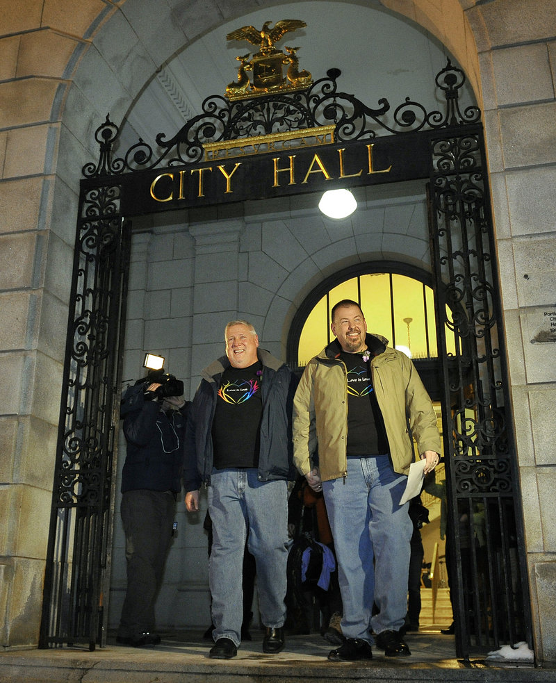 """The first to wed: Michael Snell, left, and Steven Bridges leave Portland City Hall early Saturday after becoming the first gay couple to be married in Maine. The mayor said theirs """"may be the most covered marriage"""" in the state's history."""