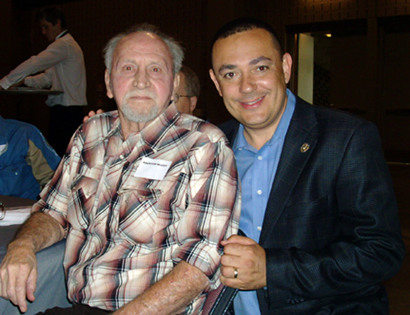 Retired Officer Houston McCoy, left, poses with Austin Police Chief Art Acevedo in 2010. McCoy helped stop Charles Whitman's 1966 sniper rampage at the University of Texas.