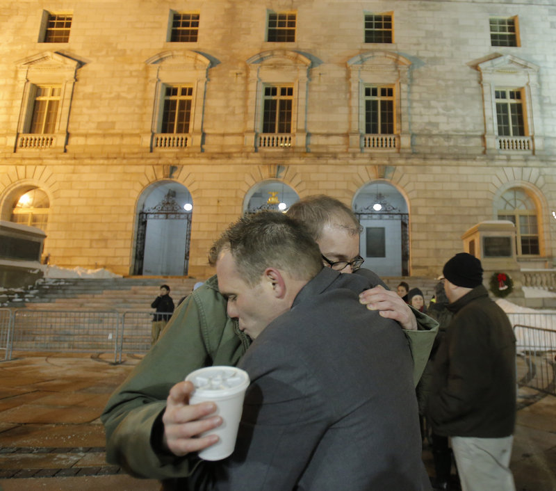 Coming to Portland from Augusta to support same-sex couples, Matthew Martin, left, and Russell Vonaa embrace outside City Hall on Saturday.
