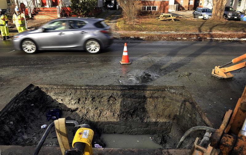 Crews work to repair a water main break on Dartmouth Street in Portland on Dec. 20.