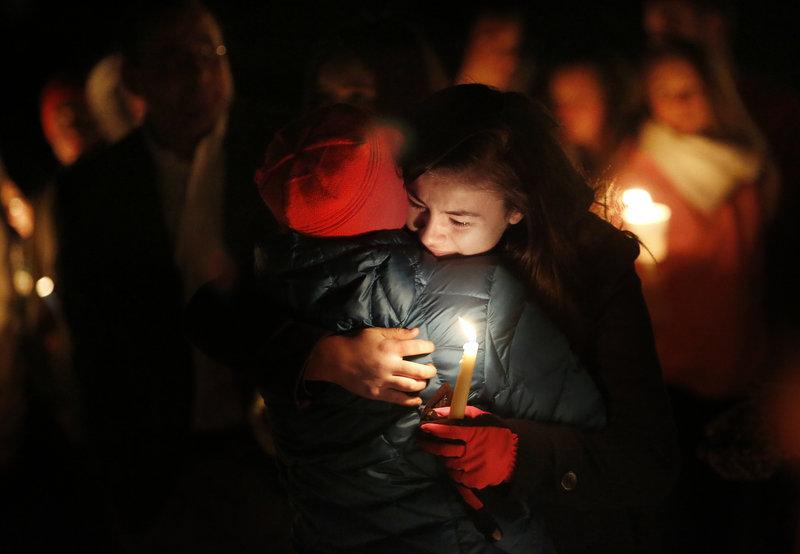 Maria McKeown of Biddeford embraces her aunt Carol LaMontagne of Biddeford at the vigil.