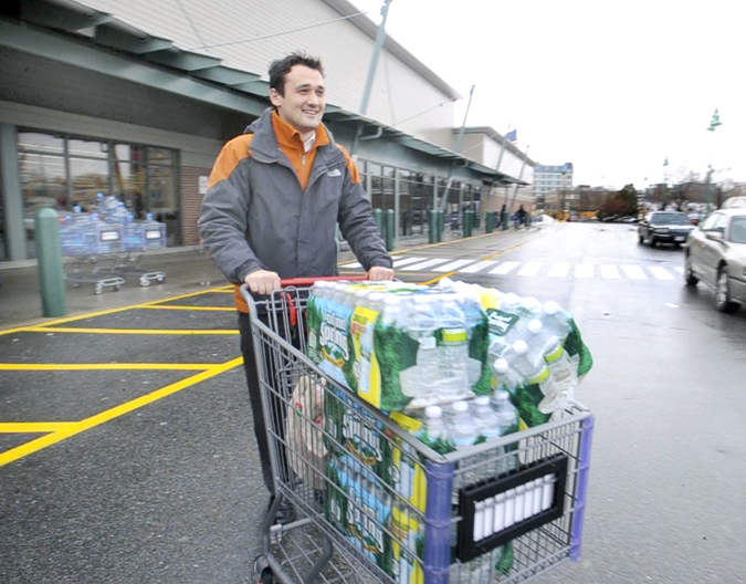Alen Saric assistant general manager of Residence Inn in Portland, leaves Hannaford Supermarket with his second load of drinking water for his customers. A boil drinking water alert was issued for Portland by the Portland Water District after a water main broke.