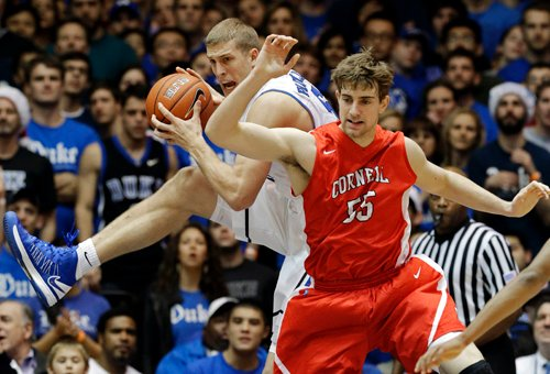 Duke's Mason Plumlee grabs a rebound against Cornell's Eitan Chemerinski during the first half of Duke's 88-47 win at Durham, N.C., on Wednesday. Plumlee had 18 points for the top-ranked Blue Devils. NCAA