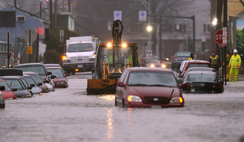 A bucketloader approaches a submerged van on Somerset Street in Portland on Dec. 19, 2012, after a water main break caused flooding through much of the area.