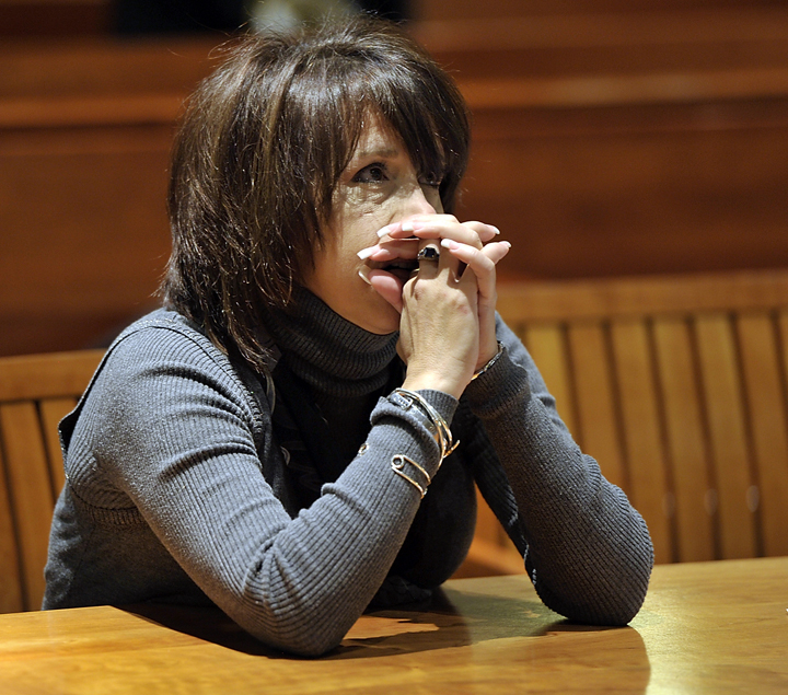 On Wednesday, January 9, 2013, Tammy Cole, mother of Gage and Derek Greene is suing Rory Holland for the murder of her sons. Here she listens to testimony from the first witness. Trial was continued when Rory Holland, who was going to represent himself and was in prison in Thomaston, was going to be about two hours late and the Cole did not want to wait.