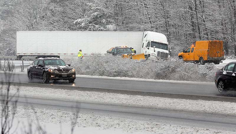 A tractor trailer truck jackknifed across I-295 Southbound just past Exit 17 in Yarmouth on Wednesday, January 16, 2013, as a winter storm caused slippery roads throughout Maine.
