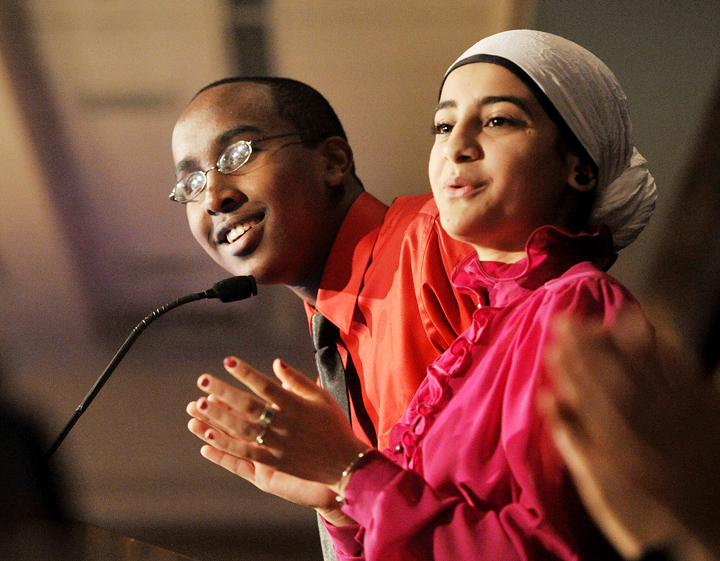 Mohamed Nur, a sophmore at Deering High School, left, and Casco Bay High School senior Fatma Adnad served as masters of ceremonies at the Martin Luther King Day breakfast held at the Holiday Inn by the Bay.