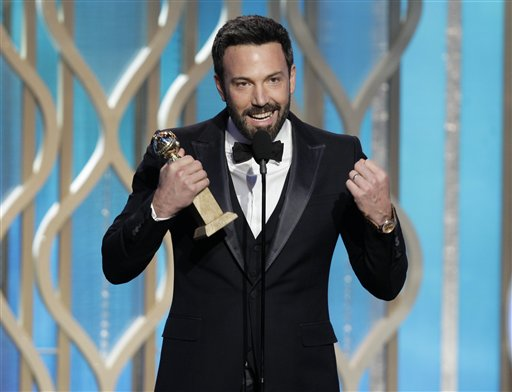 Ben Affleck holds his award for best director for