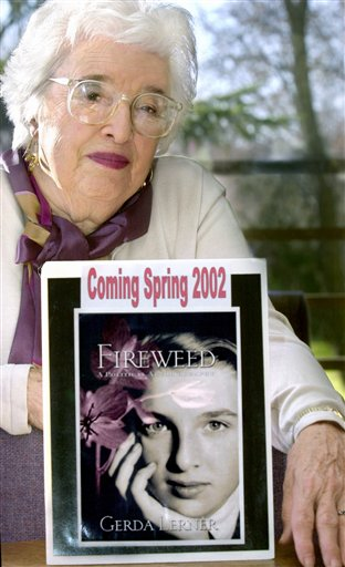 This 2001 photo shows Gerda Lerner, founder of University of Wisconsin-Madison's graduate program in women's history, with an image of her autobiography, Fireweed. Lerner, a founding member of the National Organization for Woman and a pioneer in the field of women�s history, has died at an assisted-living facility in Madison. She was 92. (AP Photo/Wisconsin State Journal, Sarah B. Tews) FRONT;A1;BOOK;UW;HISTORY