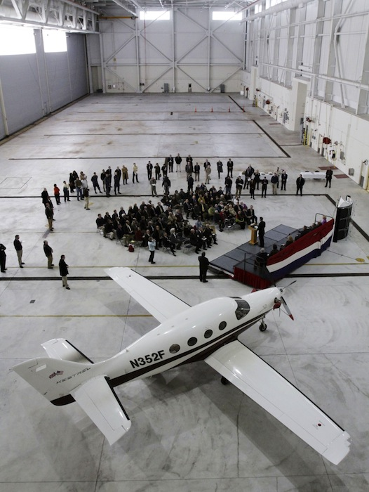 In this February 2011 file photo, Kestrel Aircraft Company shows off one of its planes during a ceremony at the former Brunswick Naval Air Station. Officials in Brunswick say the LePage administration appears to be meddling in a tax dispute between the town and the agency that's redeveloping the former air station. The complaint centers on L.D. 492, a bill the LePage administration submitted to clarify the law exempting some aviation companies like Kestrel from paying property taxes. (AP Photo/Pat Wellenbach)