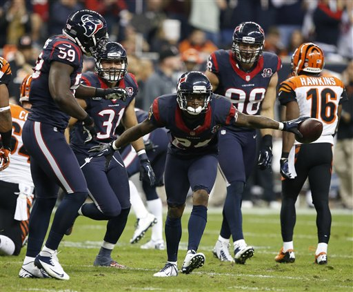Houston Texans running back Arian Foster (23) celebrates a first down during the second half of the Texans' AFC Playoff game against the Cincinnati Bengals on Saturday.