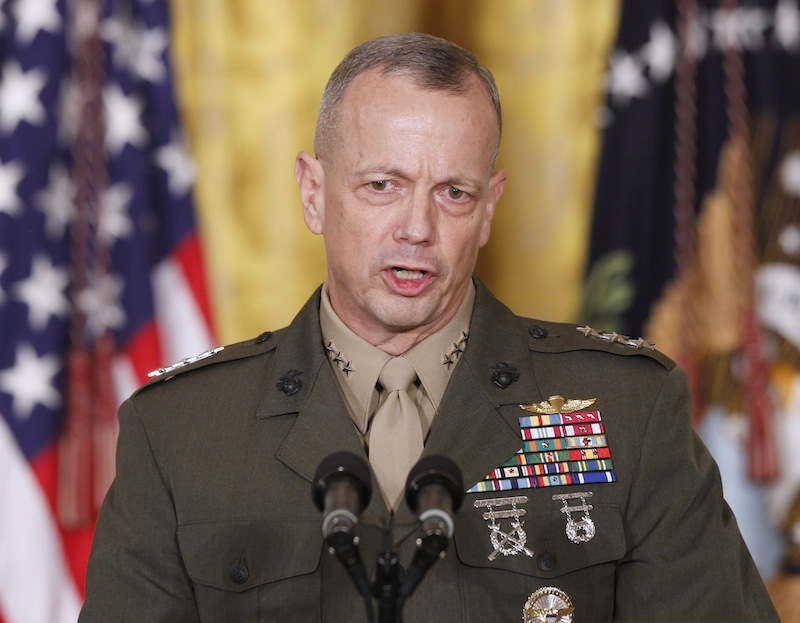 In an April 28, 2011, file photo then-Lt. Gen. John Allen, speaks in the East Room of the White House in Washington. U.S. defense officials say Gen. Allen, the top U.S. commander in Afghanistan, has been cleared of allegations of sending potentially inappropriate emails to a civilian woman linked to the sex scandal that ousted David Petraeus as CIA director. The officials said Tuesday, Jan. 22, 2012, the Defense Department's inspector general found the concerns about the Allen emails to be