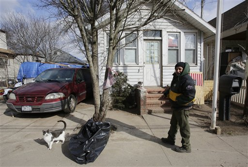 Eddie Saman walks to his home on Wednesday in the borough of Staten Island in New York. The house was badly damaged by Superstorm Sandy and will have to be renovated. Meanwhile, because of the extreme cold weather, Saman has been spending the night in a tent nearby operated by the volunteer group Cedar Grove Community Hub.
