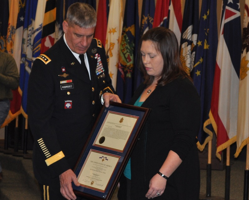 In this photo provided by the U.S. Army, Gen. David M. Rodriguez, commander of the Army's U.S. Forces Command, presents a Distinguished Service Cross to Audrey Shaw, widow of Staff Sgt. Eric B. Shaw, during a ceremony held Wednesday, Jan. 16, 2013, at Fort Campbell, Ky. Shaw, who was killed in June 2010, is credited with saving the lives of 12 Afghan Army soldiers during a mission in Kunar Province, Afghanistan. (AP Photo/U.S.Army)