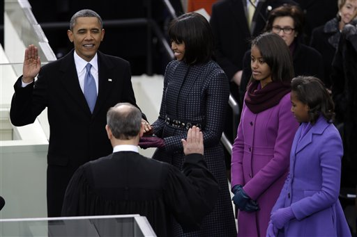 President Barack Obama receives the oath of office from Chief Justice John Roberts as first lady Michelle Obama and his daughters Malia and Sasha listen at the ceremonial swearing-in at the U.S. Capitol on Monday.