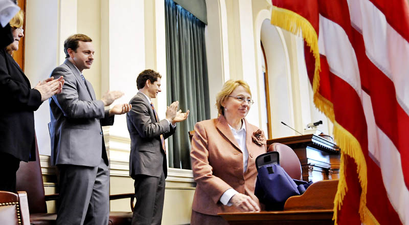 Staff photo by Andy Molloy OFFICERS: Attorney General Janet Mills is applauded by Senate President Justin Alfond, second from right, Speaker of the House Mark Eves and Supreme Court Chief Justice Leigh Saufley Monday January 7, 2013 at the House of Representatives in Augusta after Mills was sworn into the office of as Maine's top law enforcement officer.