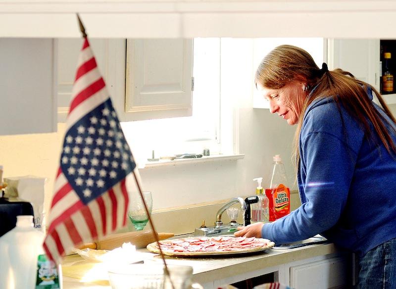 Elizabeth Tremblay makes focaccia pizza at her Poland, Maine, home on Januaray 7, 2013.