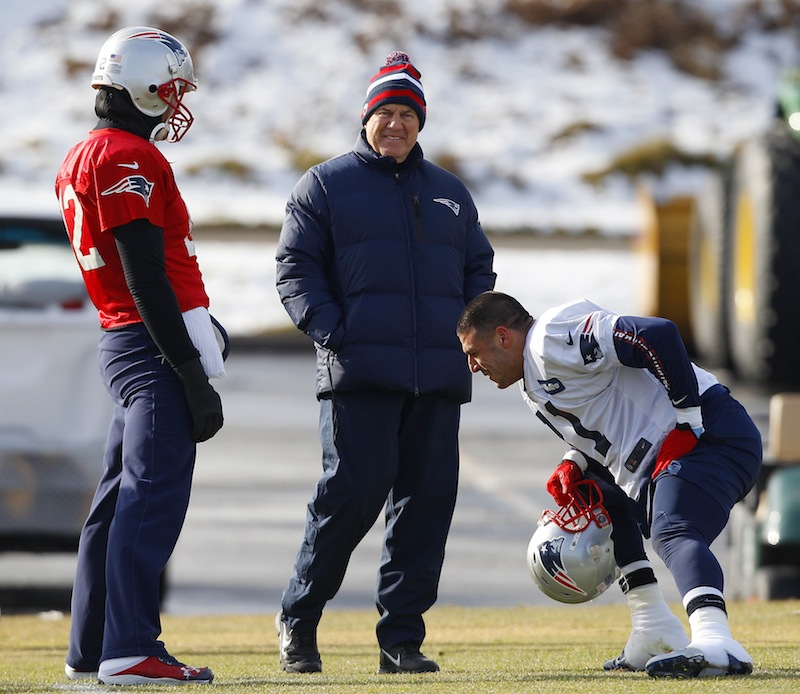 New England Patriots head coach Bill Belichick, center, smiles as he talks with quarterback Tom Brady (12) and tight end Aaron Hernandez (81) during practice at the NFL football team's facility Thursday, Jan. 17, 2013, in Foxborough, Mass. The Patriots will play the Baltimore Ravens in the AFC Championship game for the second year in a row at Foxborough this Sunday. (AP Photo/Stephan Savoia)