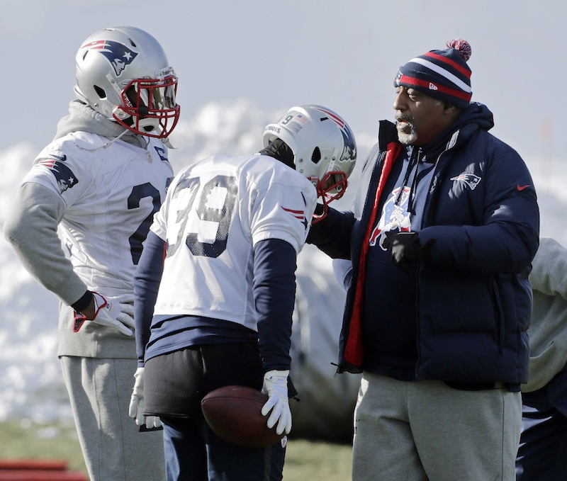 New England Patriots running back coach Ivan Fears, right, instructs running backs Stevan Ridley (22) and Danny Woodhead (39) during NFL football practice in Foxborough, Mass., Wednesday, Jan. 2, 2013. . The Patriots don't know who they'll face in their playoff opener. But, they do know plenty about that team. They are familiar with all three potential opponents, the Texans, Ravens and Colts, having played them already this season. (AP Photo/Charles Krupa)