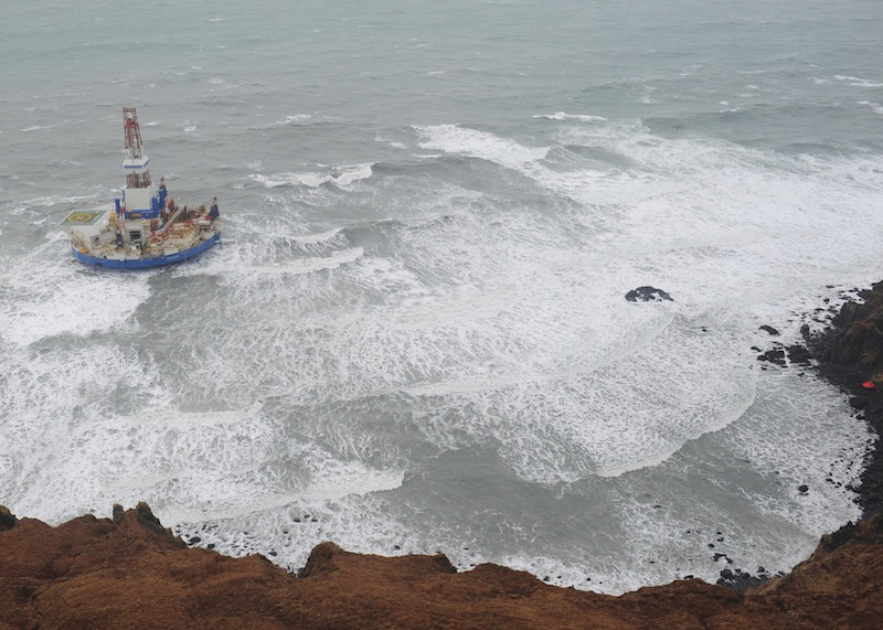 This aerial image provided by the U.S. Coast Guard shows the Royal Dutch Shell drilling rig Kulluk aground off a small island near Kodiak Island Tuesday Jan. 1, 2013. No leak has been seen from the drilling ship that grounded off the island during a storm, officials said Wednesday, as opponents criticized the growing race to explore the Arctic for energy resources. (AP Photo/U.S. Coast Guard)