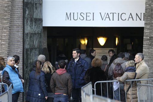 People queue to enter the Vatican Museums at the Vatican earlier this month. It's