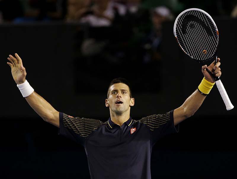 Novak Djokovic celebrates his fourth-round win over Stanislas Wawrinka at the Australian Open Monday. Djokovic needed five sets and more than 5 hours to advance.