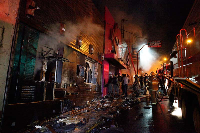 Firefighters work to locate and assist survivors after an early-morning fire at the Kiss Club in Santa Maria, Brazil, on Sunday. The latest death toll was at 233, officials said.