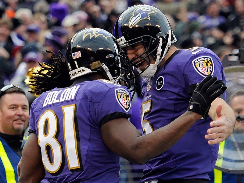 Anquan Boldin, left, of the Ravens celebrates his touchdown catch with quarterback Joe Flacco in Sunday's wild-card playoff game at Baltimore. The Ravens won, 24-9.